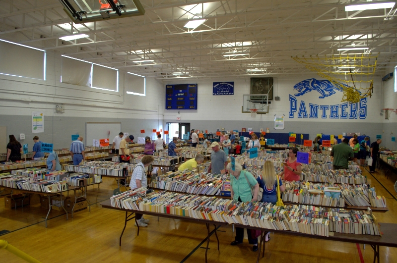 Avid readers search for the best reads at the 56th annual used book sale by the Dowers Grove branch, American Association of University Women.
