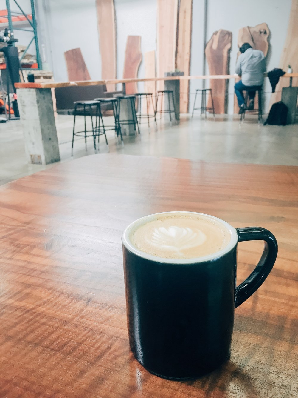 Latte art from a delicious cup of coffee at Identity Coffees in Sacramento, CA. A cool, hipster, specialty coffee shop to visit. | tintedgreen
