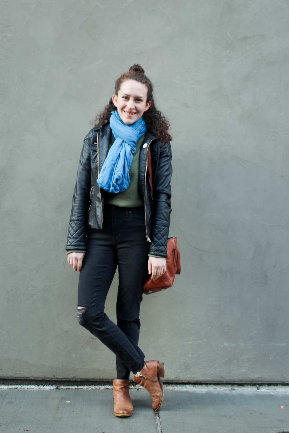 day 1 of the spring 10x10 challenge! high rise distressed denim jeans outfit with sweater tucked in and a leather jacket layered over, paired with brown leather ankle boots | tintedgreen