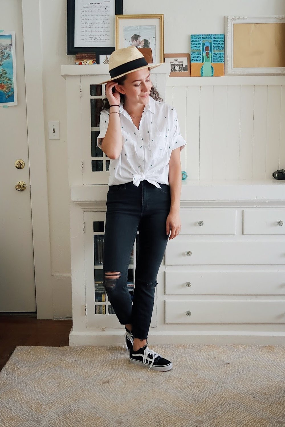 my mid-season mini haul included this cactus embroidered button up shirt from madewell. it's a perfectly subtle pattern for someone who likes simple clothes (like me). Styled with my black high rise distressed jeans, also from madewell, my low top old skool vans and a straw fedora.