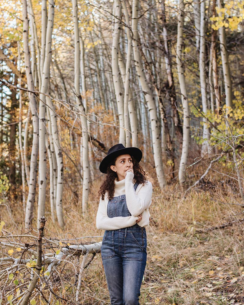 living in overalls this fall. took a little autumn walk in the woods wearing an outfit from my madewell overalls, an old madewell turtleneck sweater and my clarks desert boots