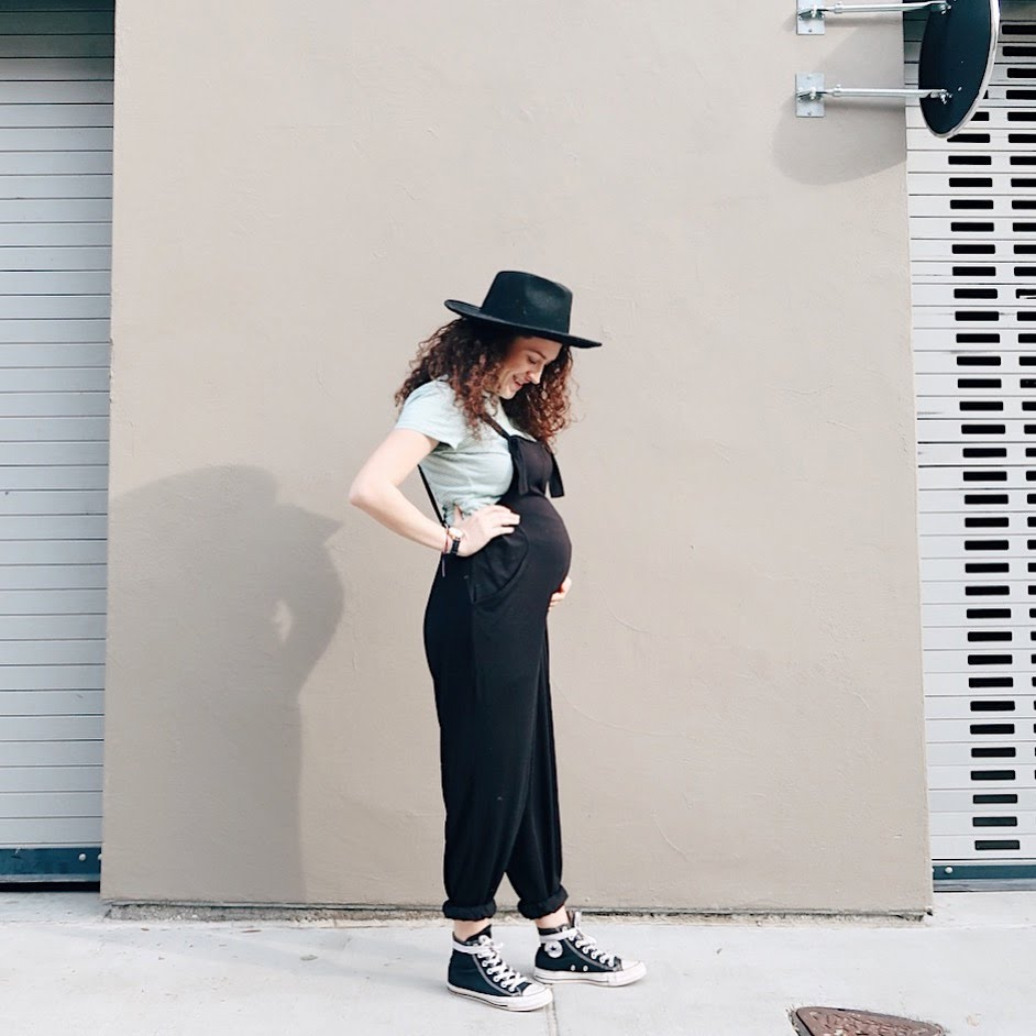maternity outfit. GAP t shirt, ASOS Maternity knit jumpsuit overall, high top converse sneakers and black wide brimmed hat