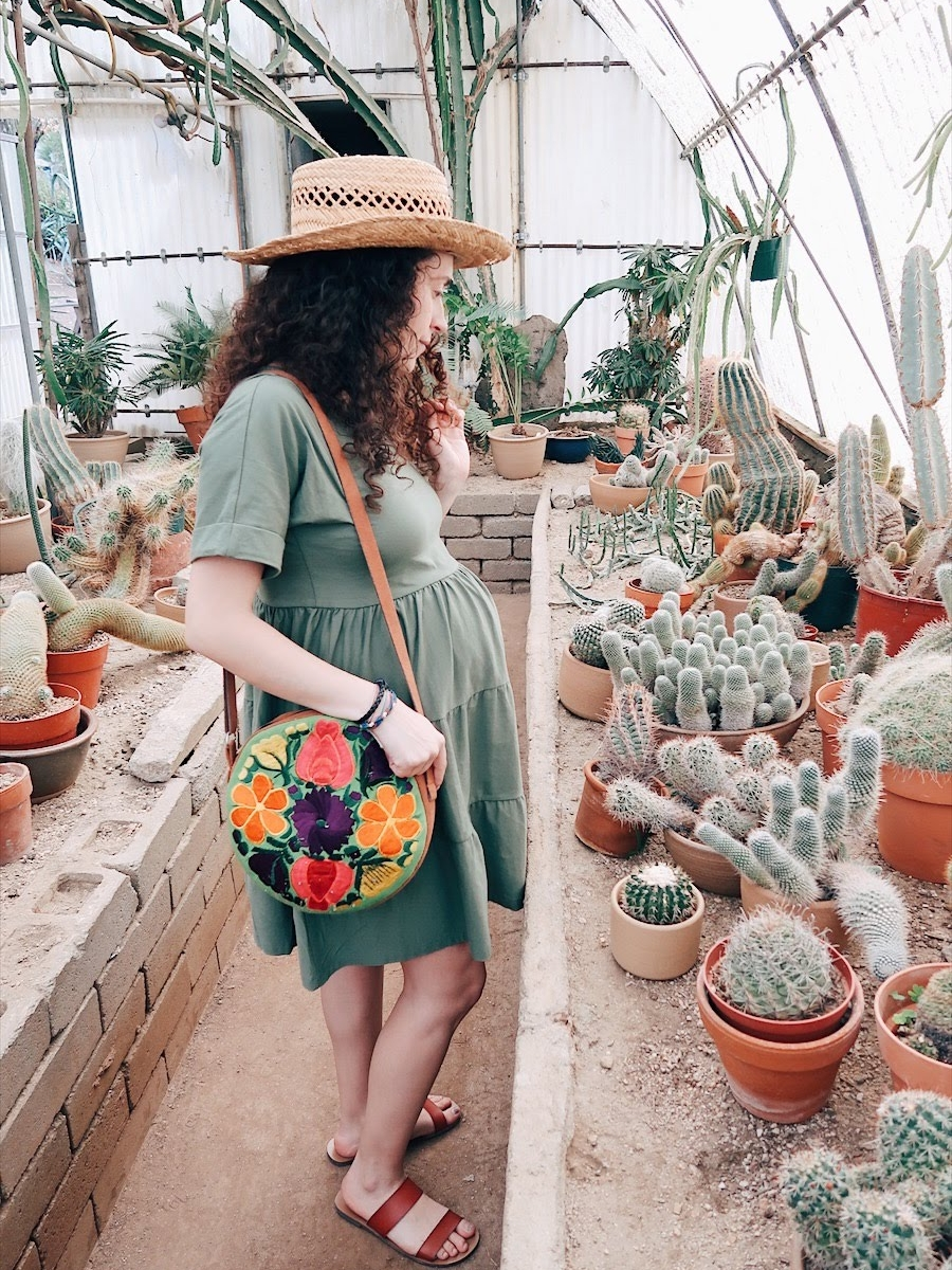 the cactaruim at moorten botanical garden is stunning! wearing a green cotton smock dress from asos, thrifted straw boater hat, and slide sandals from j crew factory | tinted green