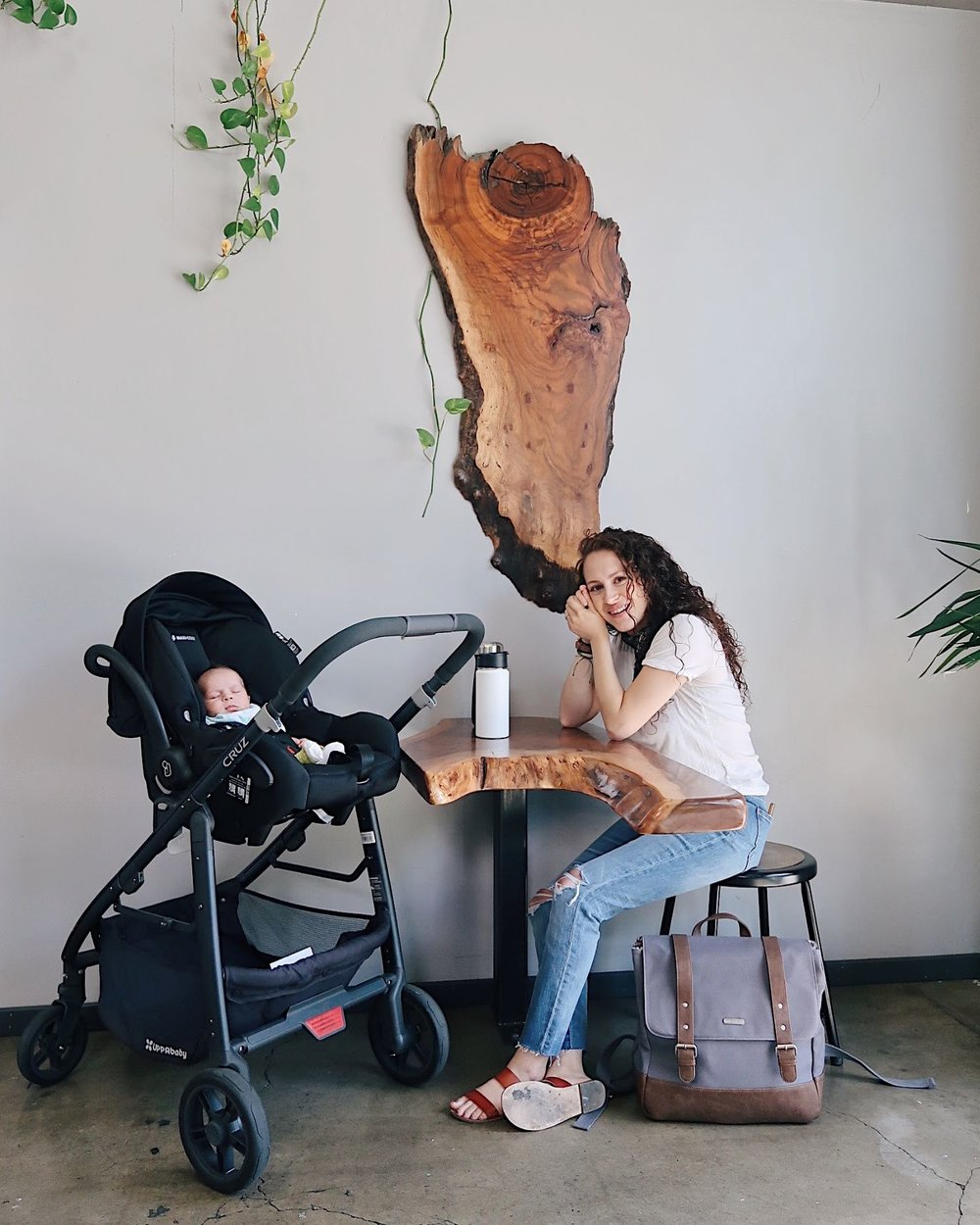 casual but chic way to wear boyfriend jeans. white v neck tee, madewell high rise slim boyjeans, slide sandals by j crew. bandana outfit. nursing friendly outfit. weekend outfit. little unicorn marindale backpack diaper bag.