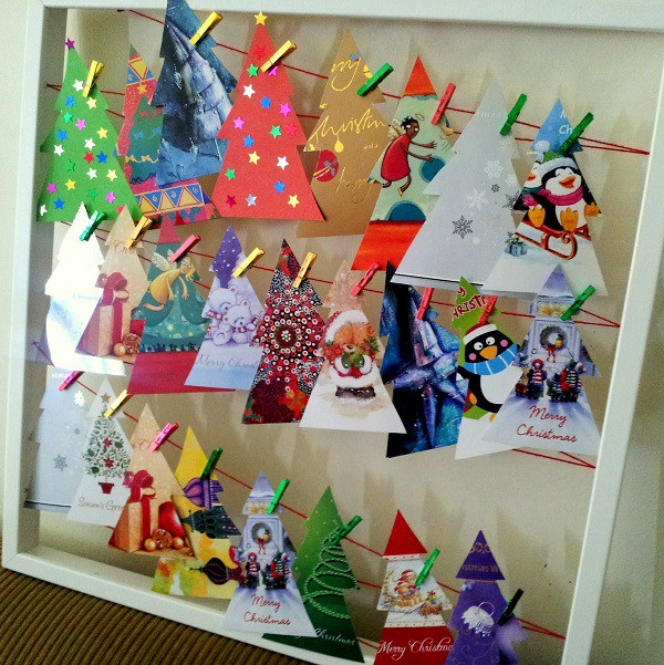 Image via http://octaviaandvicky.com/create/recycled-christmas-card-advent-calendar