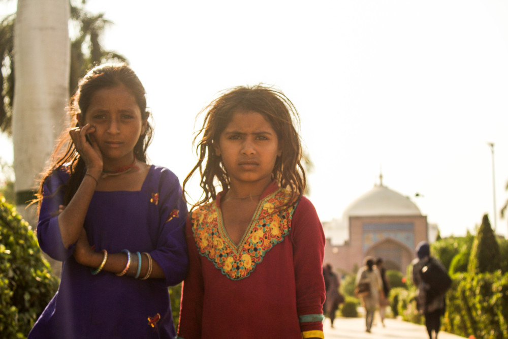 Girls pose in the garden that precedes the entrance of the Shah Jahan Masjid in Thatta (photo by Olivia Curl)