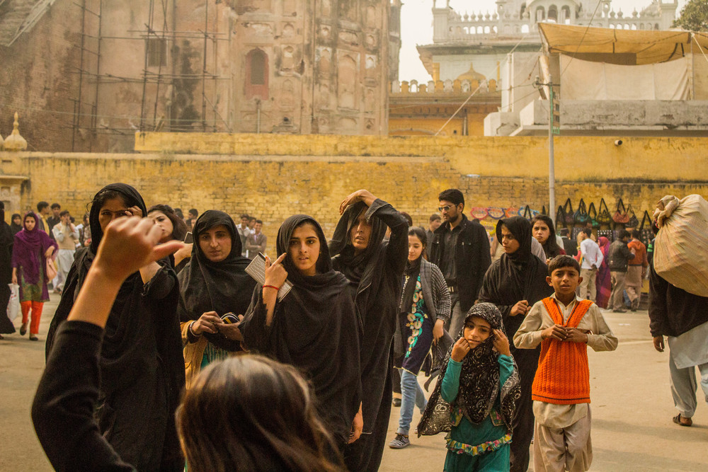 Young women pose for a group photo near the entrance to Lahore fort.
