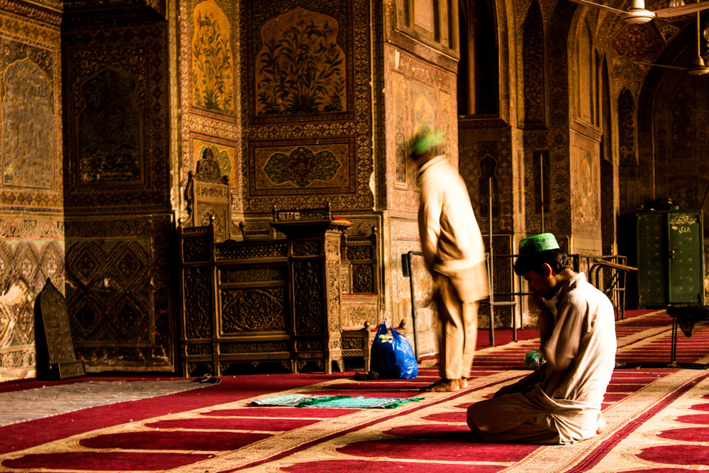 Men pray inside the main prayer area of the Wazir Khan Masjid in Old Lahore.