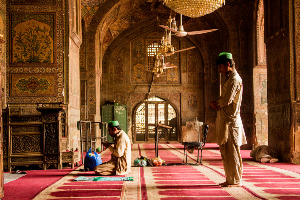 Men pray in the main prayer area of the Wazir Khan Masjid in Old Lahore.