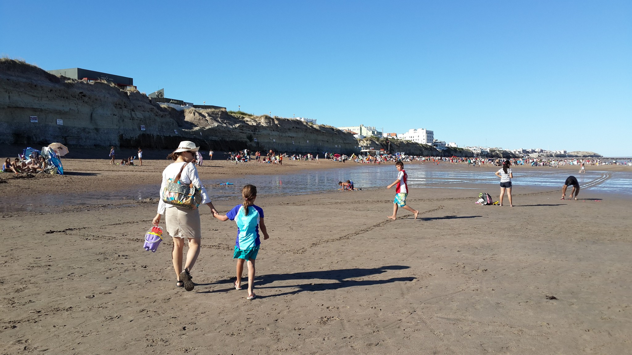 Walking along the beach in Las Grutas during low tide.