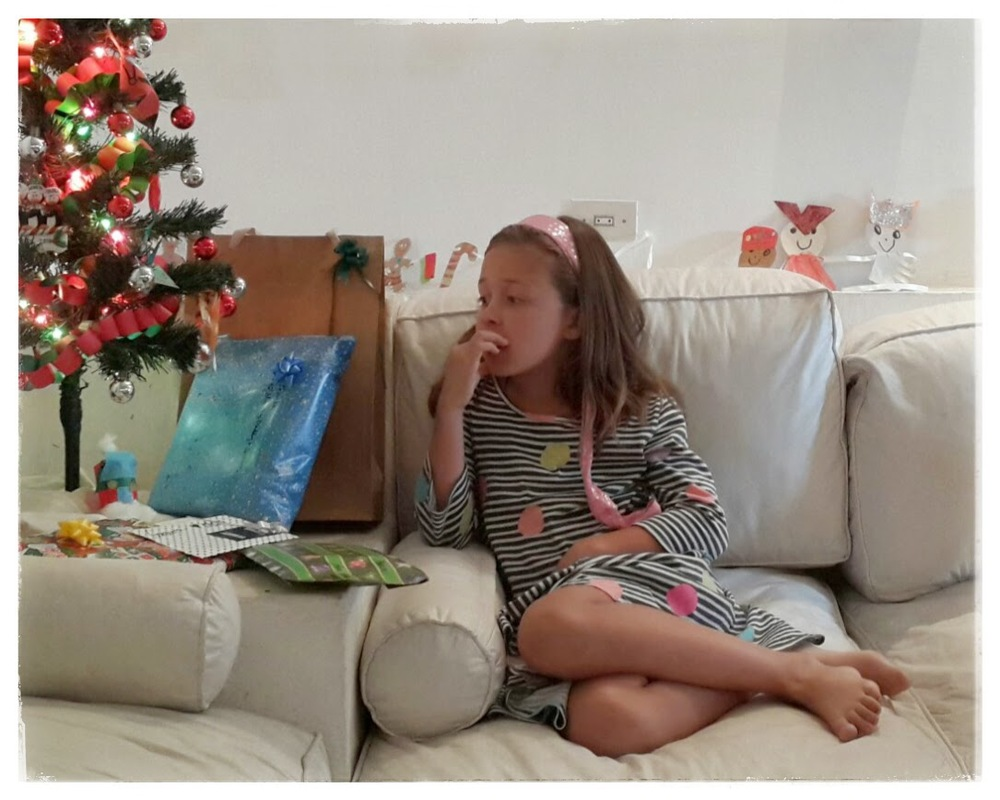 Waiting patiently to open a gift on Christmas Eve 2014.