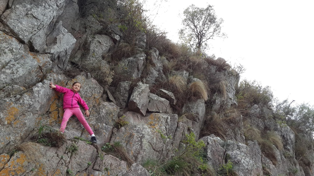 Our 7-year-old scaling a riverbank cliff. No fear!