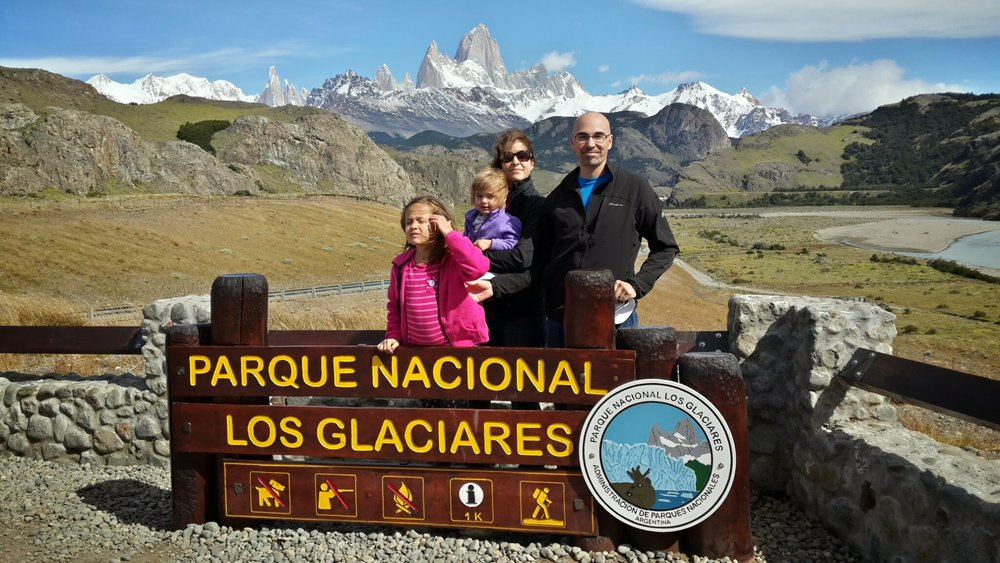 A real family photo in front of Mont Fitz Roy, near El Chaltén Argentina-- where a shaved head is a true advantage!