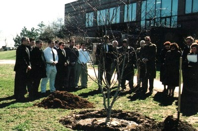 A tree dedication ceremony held at Bryant University in memory of Professor Pedro Beade, The tree was donated by the Delta Chi Fraternity.