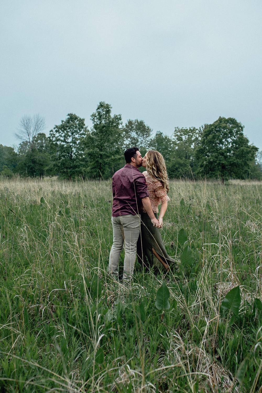 engaged-bride-and-groom-dance-in-summer-field.jpg