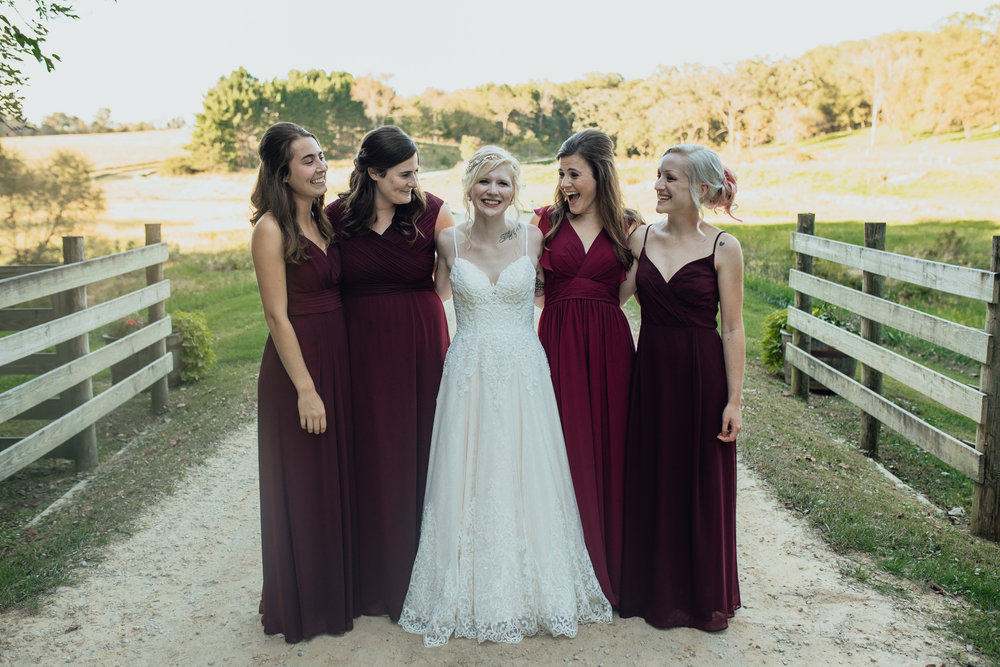 bride and bridesmaids portrait at oak hill weddings
