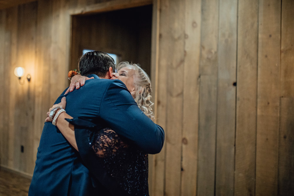 groom-hugging-first-look-with-mother-rustic-manor-1848.jpg