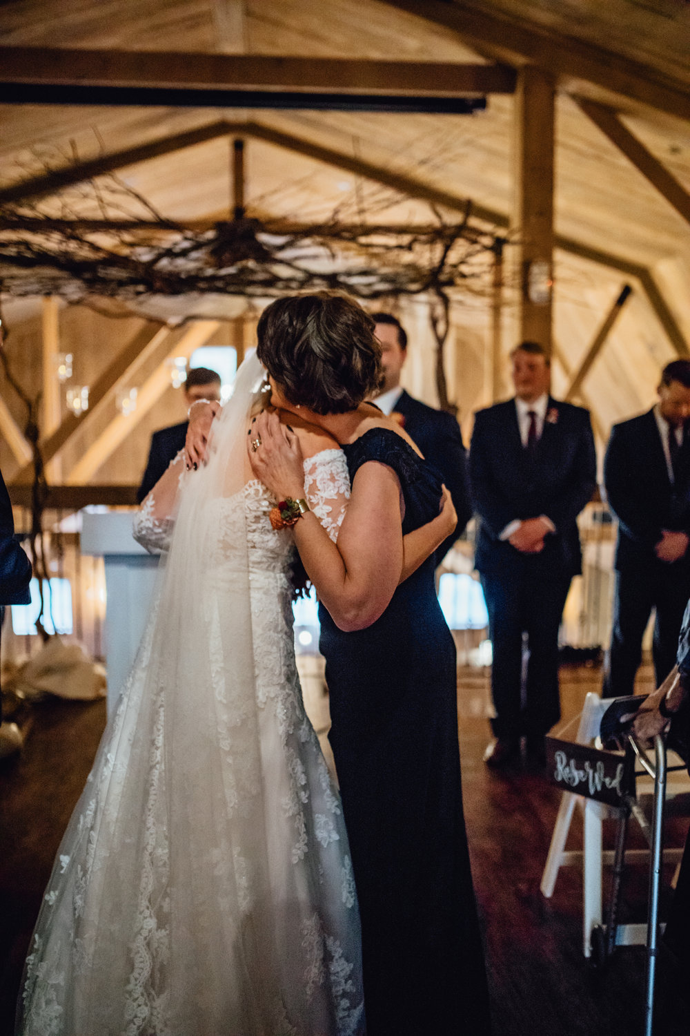 bride-hugging-mother-at-end-of-aisle-at-rustic-manor-1848.jpg