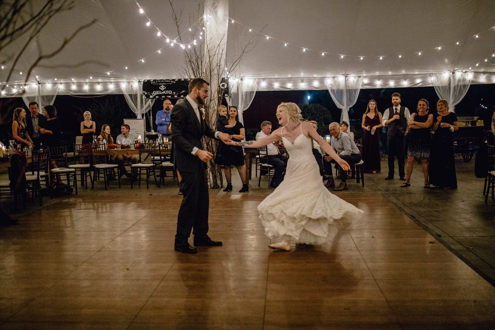 bride and groom share first dance at reception at oak hill weddings