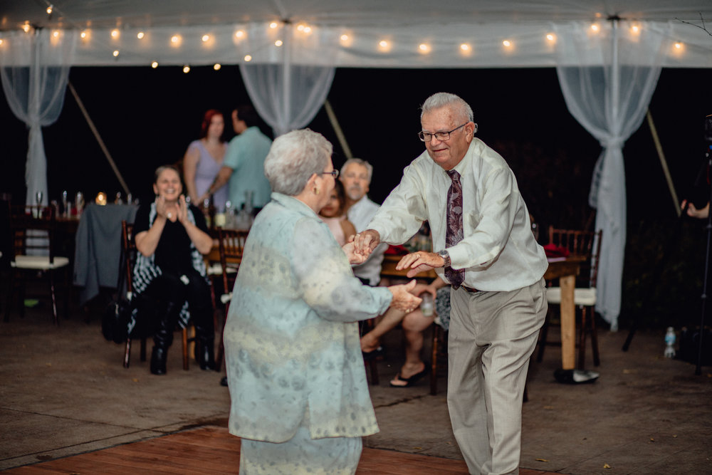 grandparents dancing under tent reception at oak hill weddings