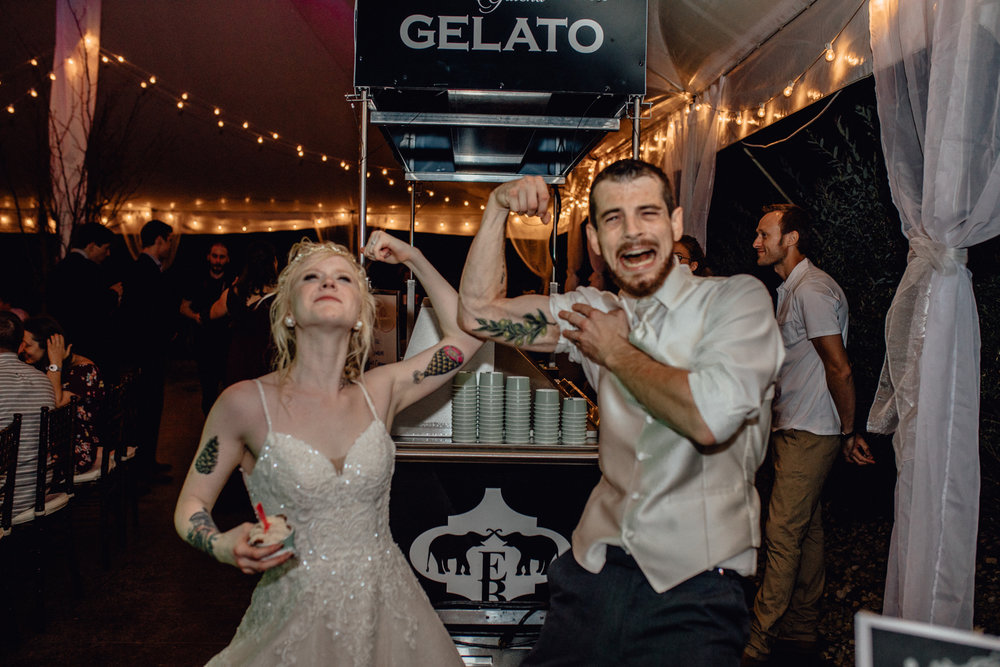 bride and groom showing muscles and tattoos at oak hill weddings reception