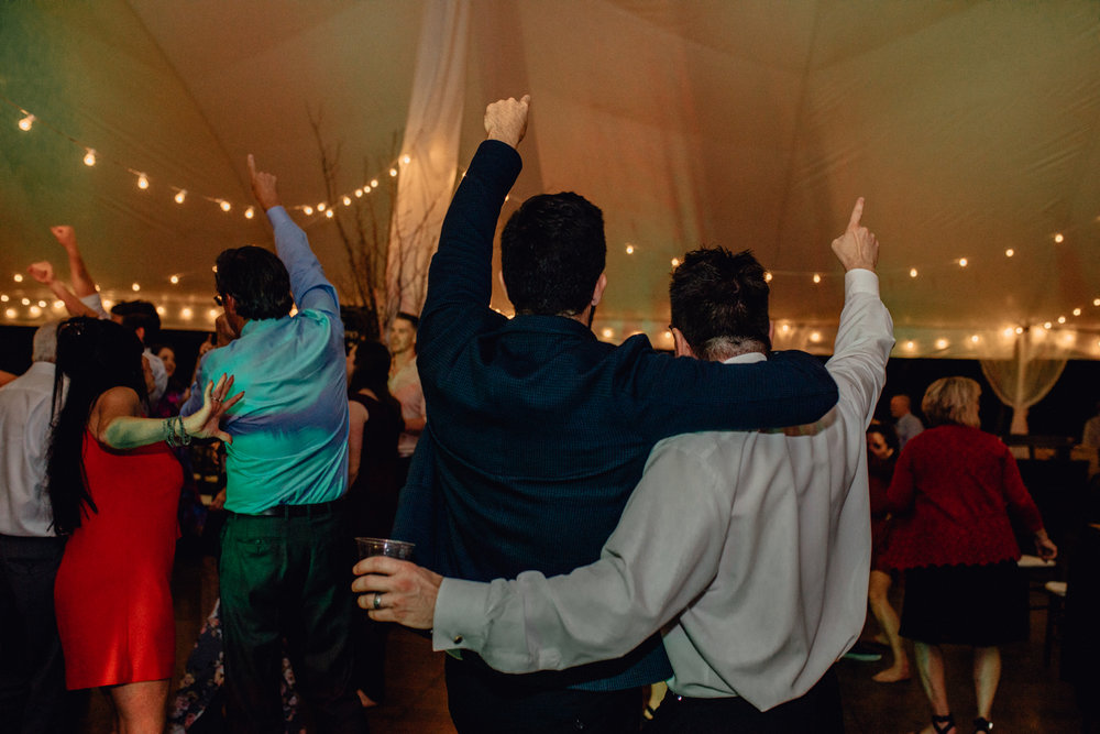 guests dancing under tent reception at oak hill weddings