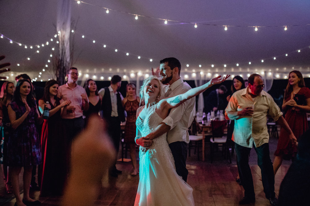 bride and groom dancing under tent reception at oak hill weddings