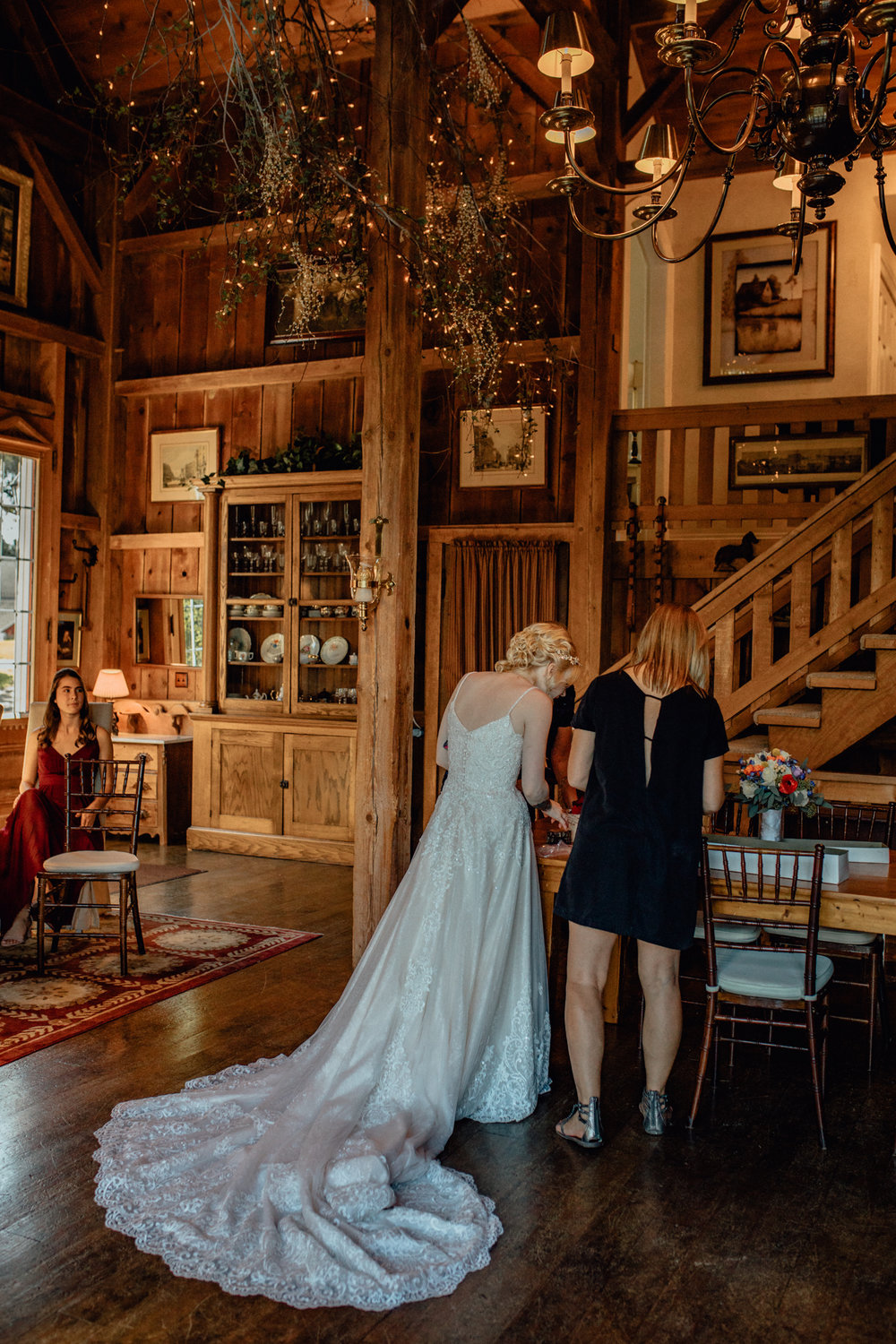 Bride before ceremony in barn at oak hill weddings