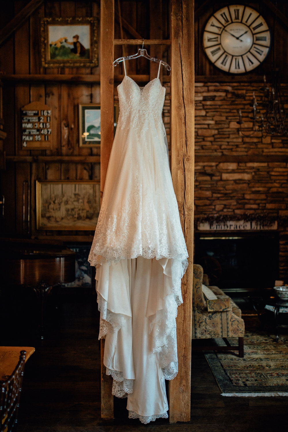 Bride's dress hanging in barn