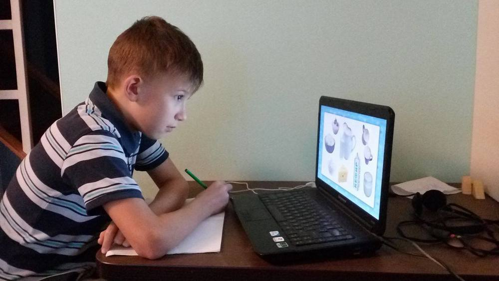 Slava learns to use the online program for homeschooling.