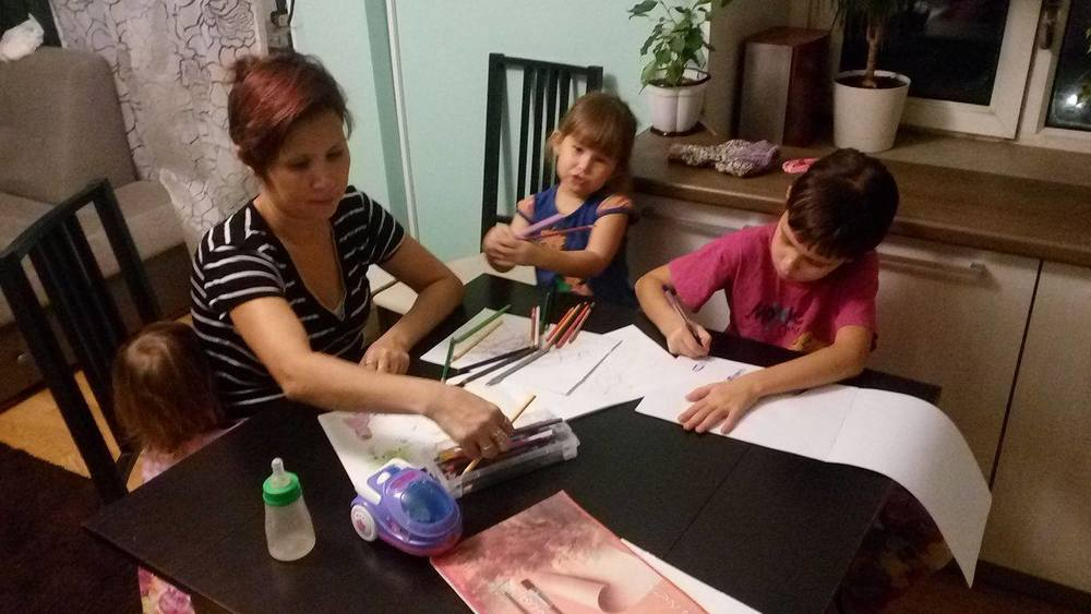 Saule works with Vera. Two of her young sisters are next in turn for homeschooling.