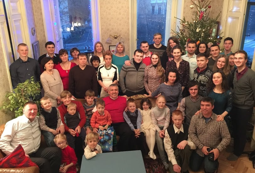 The Reformed Presbyterian Church of St. Petersburg celebrating Christmas and the fifth anniversary at the Purcell's. Pastor Oleg Volkov (front row, in the middle), elders Vlad Nebjhidovski (front row, right) and Alexander Firsanov (back row, at the right window) and all other members of this family.