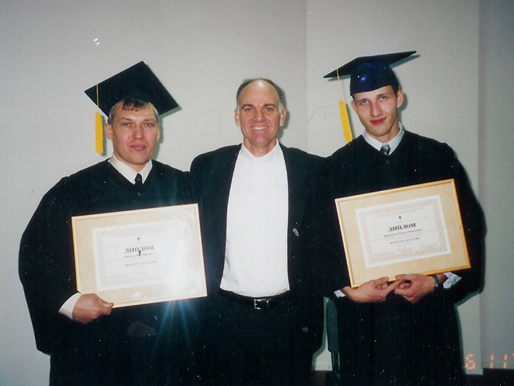 Seminary Rector Rev. Blake Purcell with Oleg (left) and Ravil (right) at their graduation ceremony.