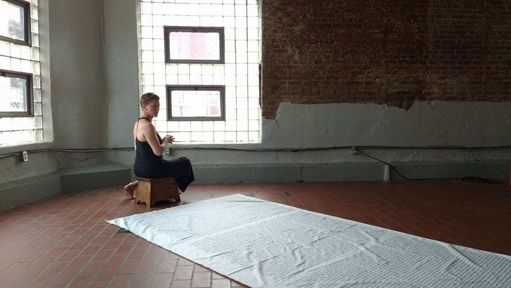 DUST. Footstool made by Zap's grandpa. Cloth/words by  Judith Leemann . Music by  Heather McIntosh . Photo by Cinthia Pérez Navarro. Performance Space:  Wherehouse Art Hotel .