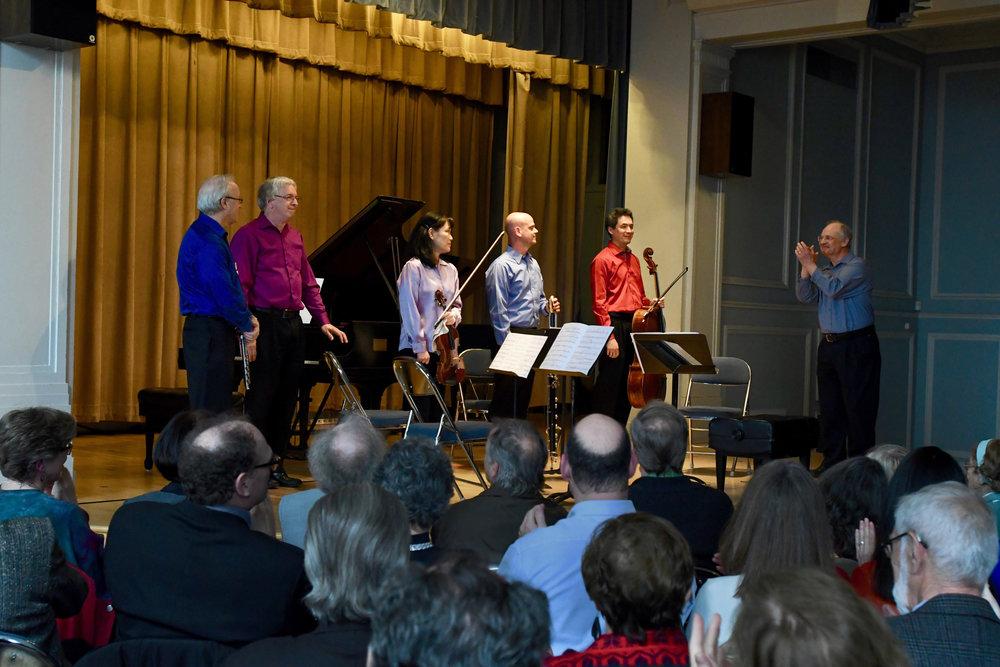"L to R: Edward Schultz, Charles Abramovic, Hirono Oka, Paul R. Demers, Thomas Kraines, Jan Krzywicki  The ensemble performed Augusta Read Thomas's ""Acrobats""."