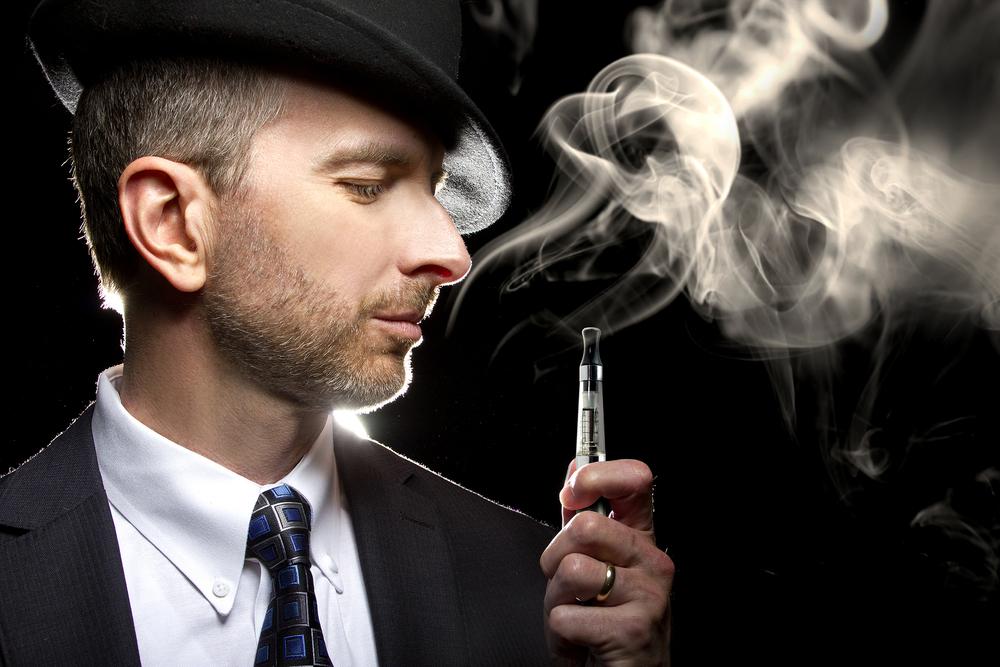 bigstock-Male-Vaping-E-Cigarette-77602508.jpg