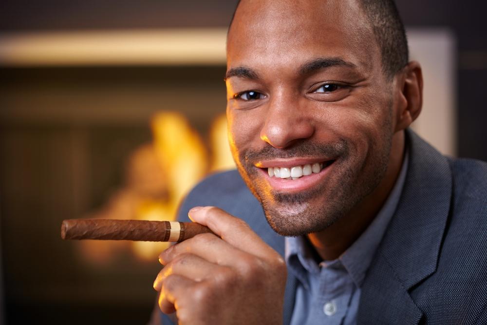bigstock-Happy-ethnic-man-smoking-cigar-36459235.jpg