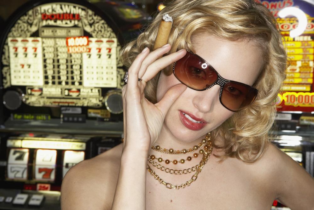 bigstock-Young-woman-smoking-a-cigar-in-73104568.jpg