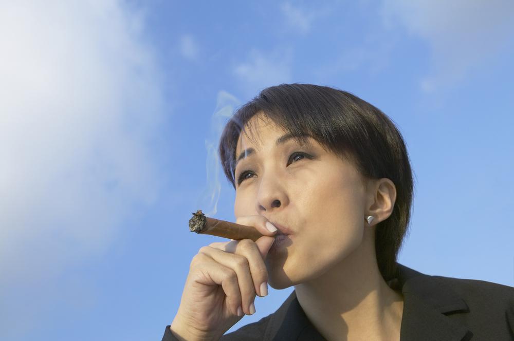 bigstock-Asian-businesswoman-smoking-ci-73162213.jpg