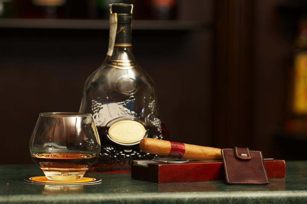 bigstock-classic-cognac-bottle-cigar-13447391.jpg