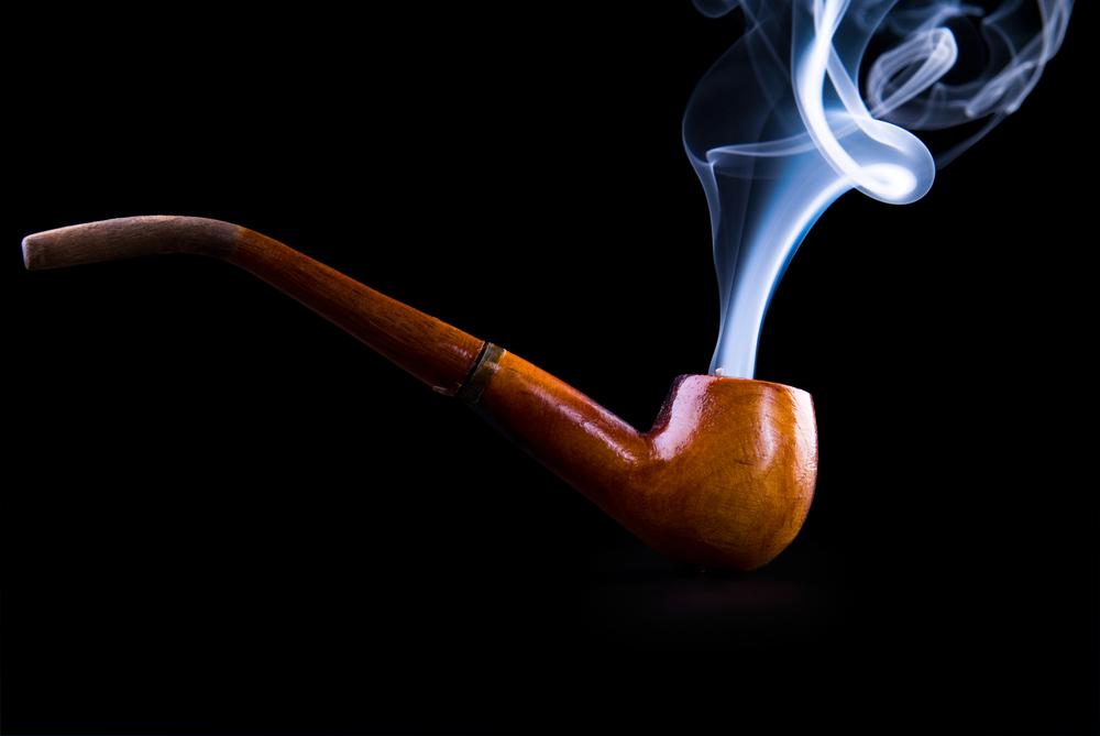 bigstock-Tobacco-Pipe-With-Smoke-6973362.jpg