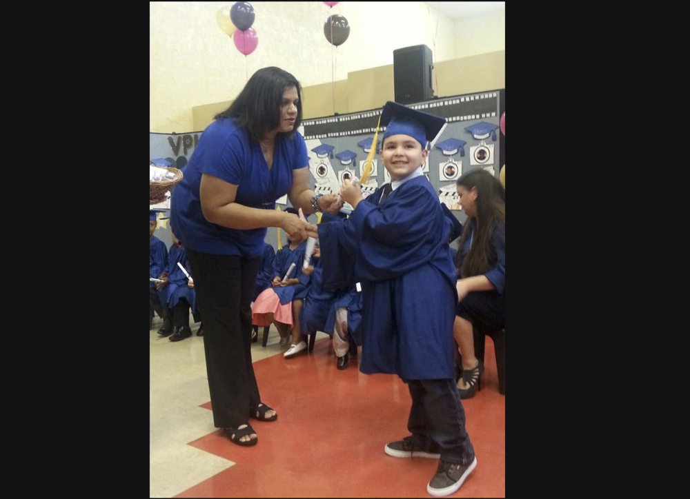 Accepting his VPK diploma