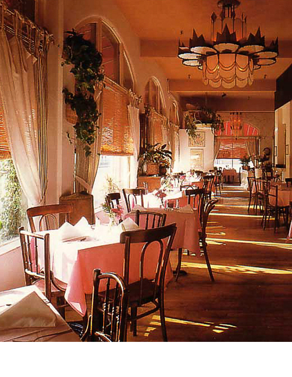 Restaurant adorned with old deco theater fixtures and broken mirror walls, inspired the hotel renovation.
