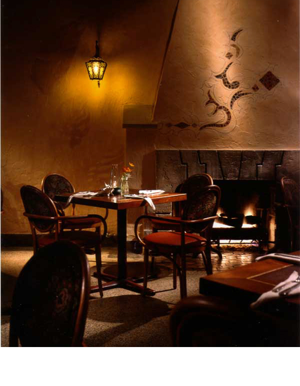 Painted leaf shadows were applied to tinted plaster walls to resemble the lighting in the Casablanca movie.
