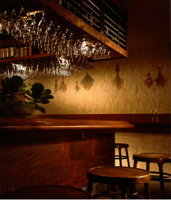 Old timbers were used in remodeling the bar and bottles rendered in egg tempura.