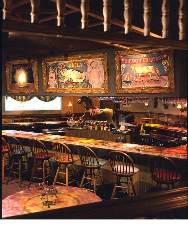 Carlos Alfonzo, who shortly after this restaurant was built became well acknowledged as an internationally acclaimed artist, designed and painted the circus art on top of the bar.