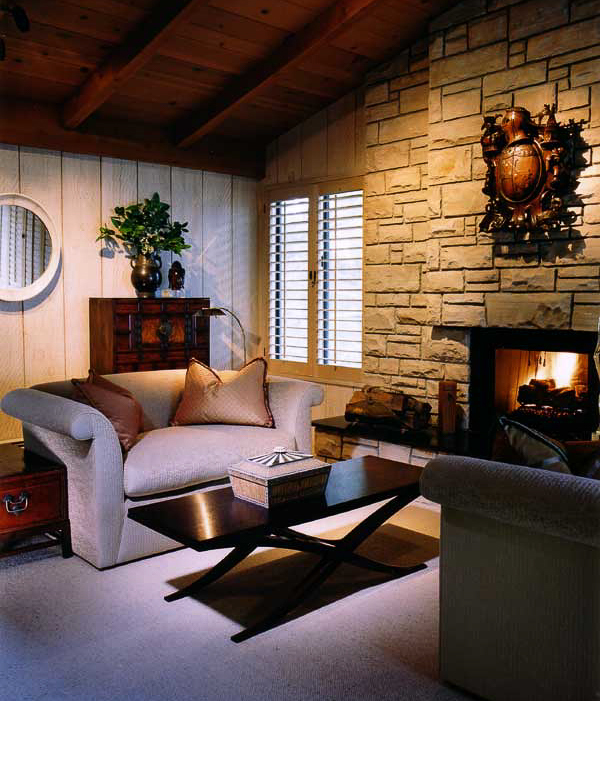 The classic Pebble Beach style fireplace wall was paramount in selecting the furnishings.