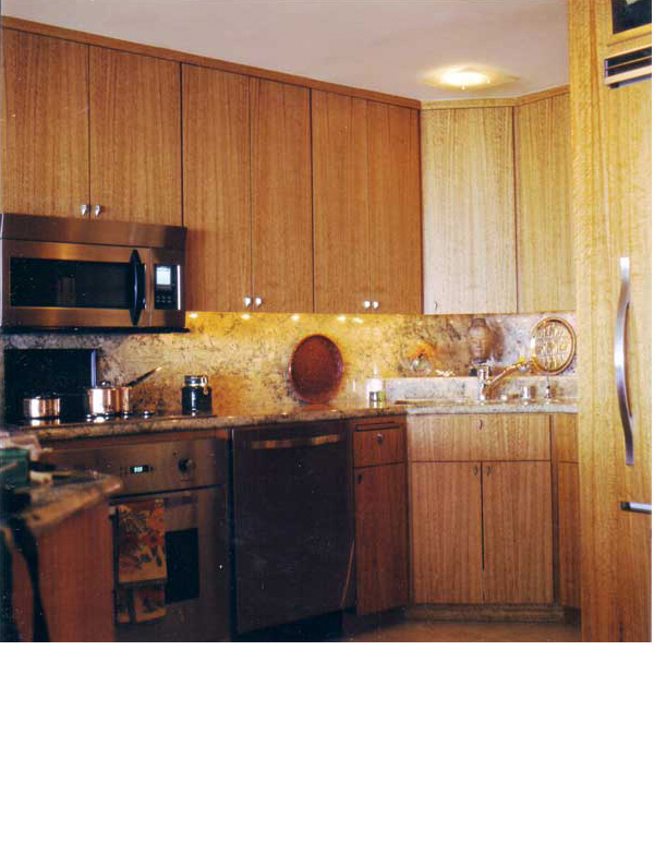 Eucalyptus cabinets unified the open kitchen and display shelving in the living room area.