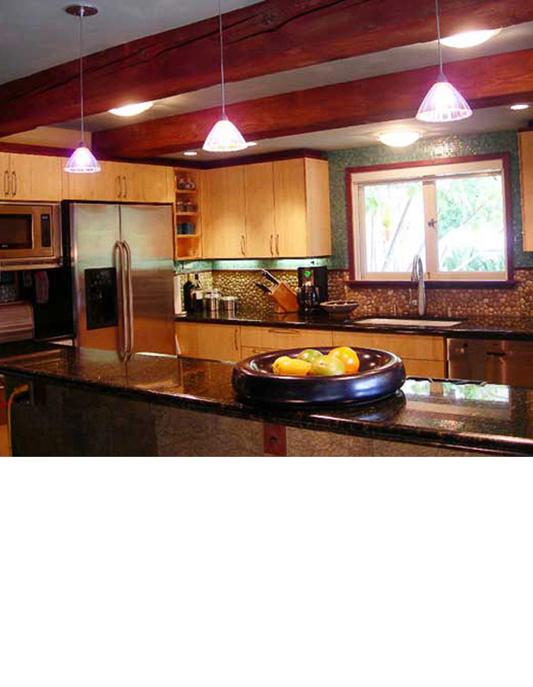 Floating ceilings were achieved by trimming the tops of cabinets in mahogany to match the color of beams.