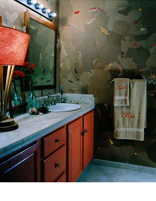Walls were made with torn paper bags and magazine scraps. Backsplash was a tumbled marble replaced in areas with shells.